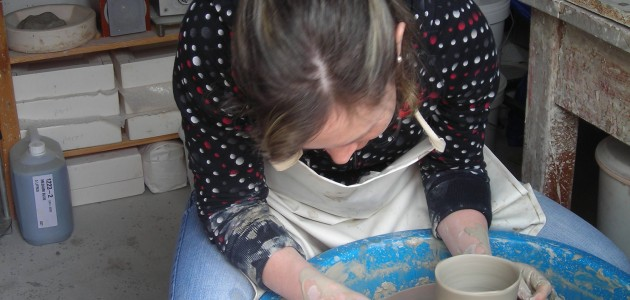Student using the potters wheel
